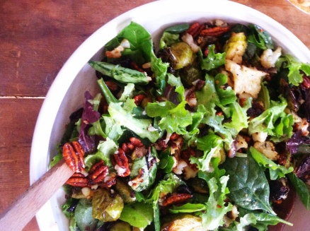 Roasted cauliflower and brussel sprout salad with wilted greens and chili sweet pecans in a truffle oil vinaigrette